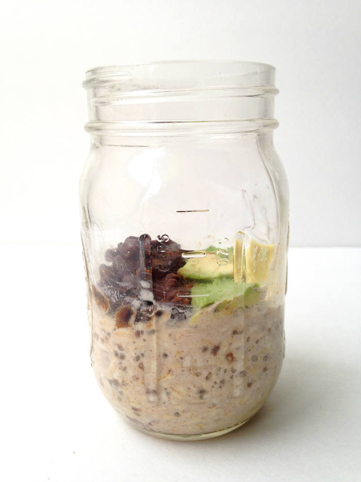 Spicy Black Bean Overnight Oats in a Jar Recipe -- A savory oatmeal breakfast topped with warm and spicy black beans. You'll never look at oats the same way again! #vegan #glutenfree