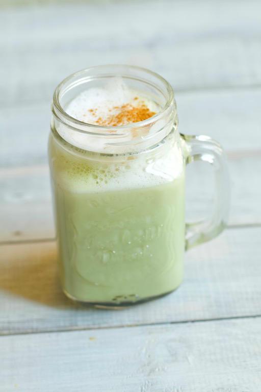 Glass mug of matcha chai latte
