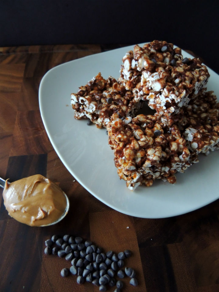 Chocolate Peanut Butter Popcorn Balls Recipe — A sweet treat made with no refined sugar or oil. Warning: These never last too long, so be prepared to make a double batch!