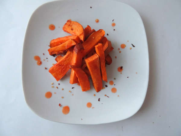 Spicy Buffalo Sweet Potato Fries Recipe -- These sweet & spicy baked fries are secretly healthy and super addicting!