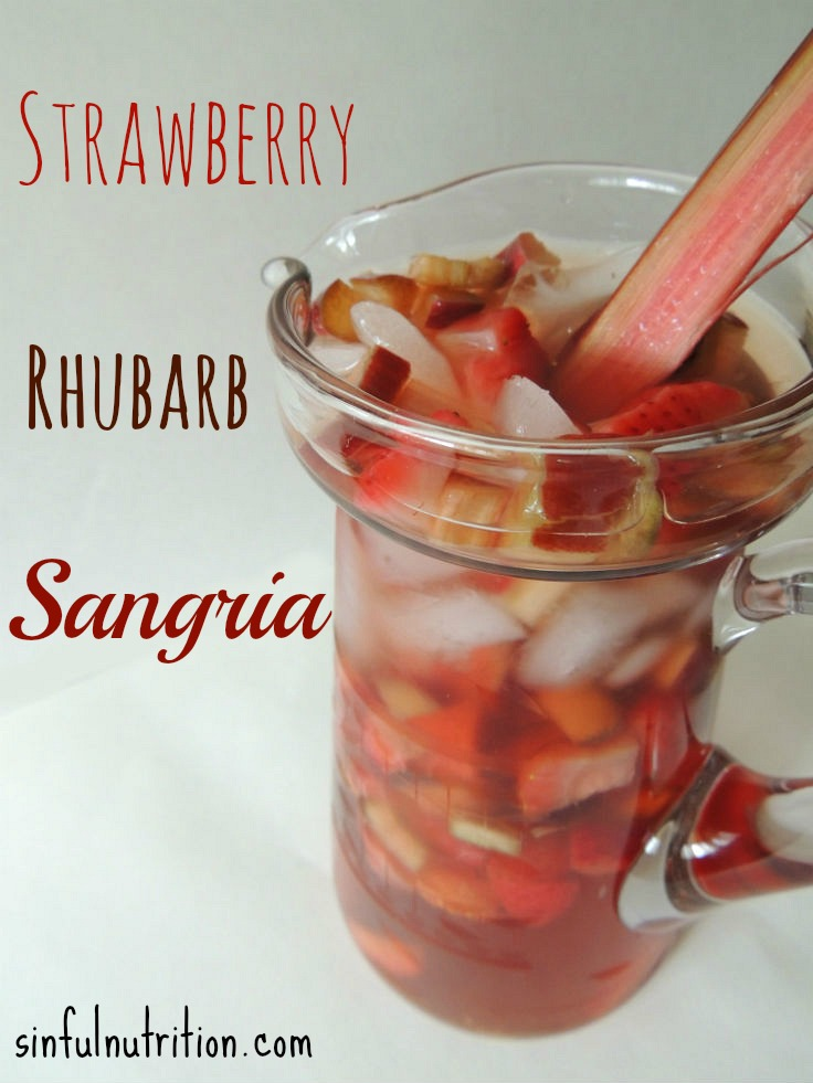 Strawberry Rhubarb Sangria Recipe -- A bubbly Spring inspired cocktail made with pink moscato, strawberry soda, frozen strawberries, and fresh rhubarb.