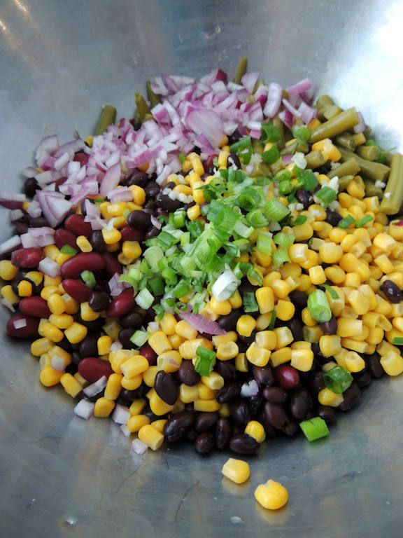 Southwestern Three Bean Salad Recipe -- A quick and easy side dish with a spicy dressing of lime juice, chili powder, garlic, and hot sauce. Just the right amount of kick! | #vegan | #vegetarian | #glutenfree | #sinfulnutrition | @sinfulnutrition | #legumes | #vegetables | #sidedish | #spicy | #summer