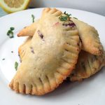 Blueberry Lemon Basil Hand Pies — An easy recipe for a unique and totally portable dessert. Perfect for summer picnics!