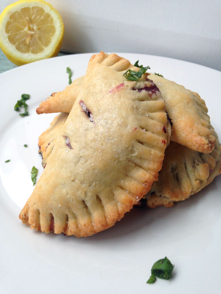 Blueberry Lemon Basil Hand Pies -- An easy recipe for a unique and totally portable dessert. Perfect for summer picnics!