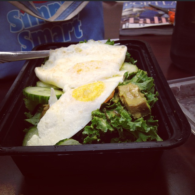 Salad with fried eggs