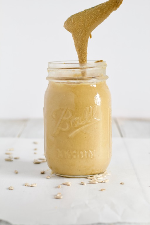 Homemade Sunflower Butter Recipe in Glass Jar Pouring into Jar