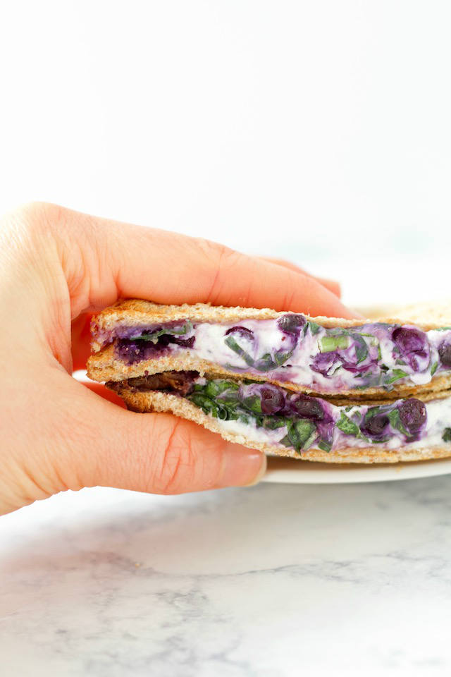 Blueberry Basil Goat Cheese Panini Sandwich in Hand