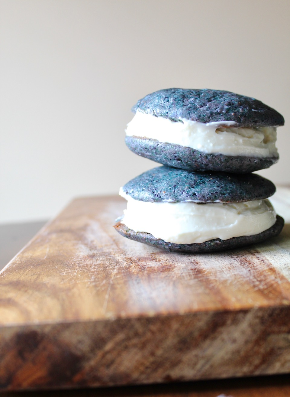 Wild Blueberry Whoopie Pies -- A colorful dessert recipe made with a wild blueberry cake and sweet cream cheese frosting! | @sinfulnutrition | AD | @WymansOfMaine