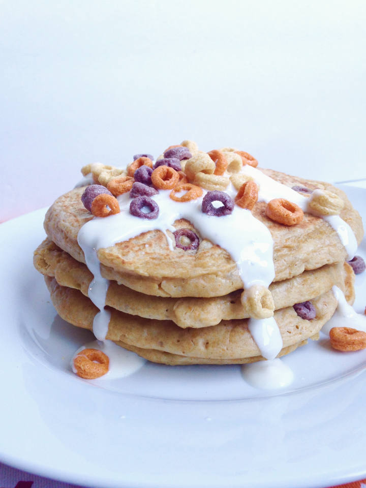 {Flourless} Milk & Cereal Pancakes Recipe -- A two for one breakfast made with cereal in the batter and a creamy Greek yogurt and almond milk glaze. #glutenfree