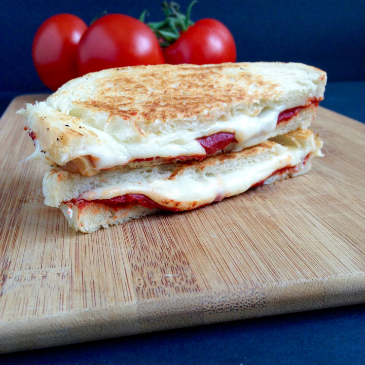 Combining a classic grilled cheese recipe with creamy tomato soup all in one sandwich! Super simple and only 3 ingredients!
