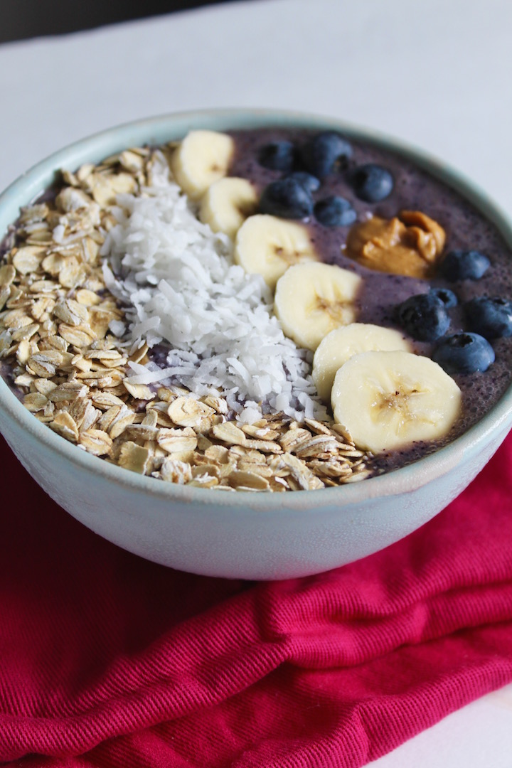 The Poor Girl's Acai Smoothie Bowl Recipe -- How to get the same experience of this trendy breakfast for a fraction of the price! Made with frozen blueberries, banana, and almond milk, with all the toppings! | @sinfulnutrition #sinfulnutrition #acaismoothiebowl #healthysmoothiebowl