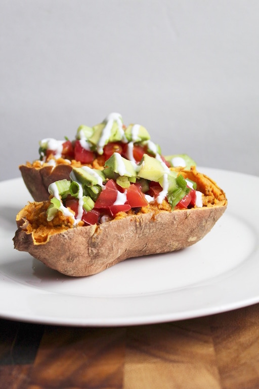 Baked Sweet Potato Tacos -- A healthy #dinner recipe that uses sweet potato skins as the #taco shell! High in fiber, protein, and #vegan-friendly! | @sinfulnutrition | #glutenfree | #vegetarian | #maindish