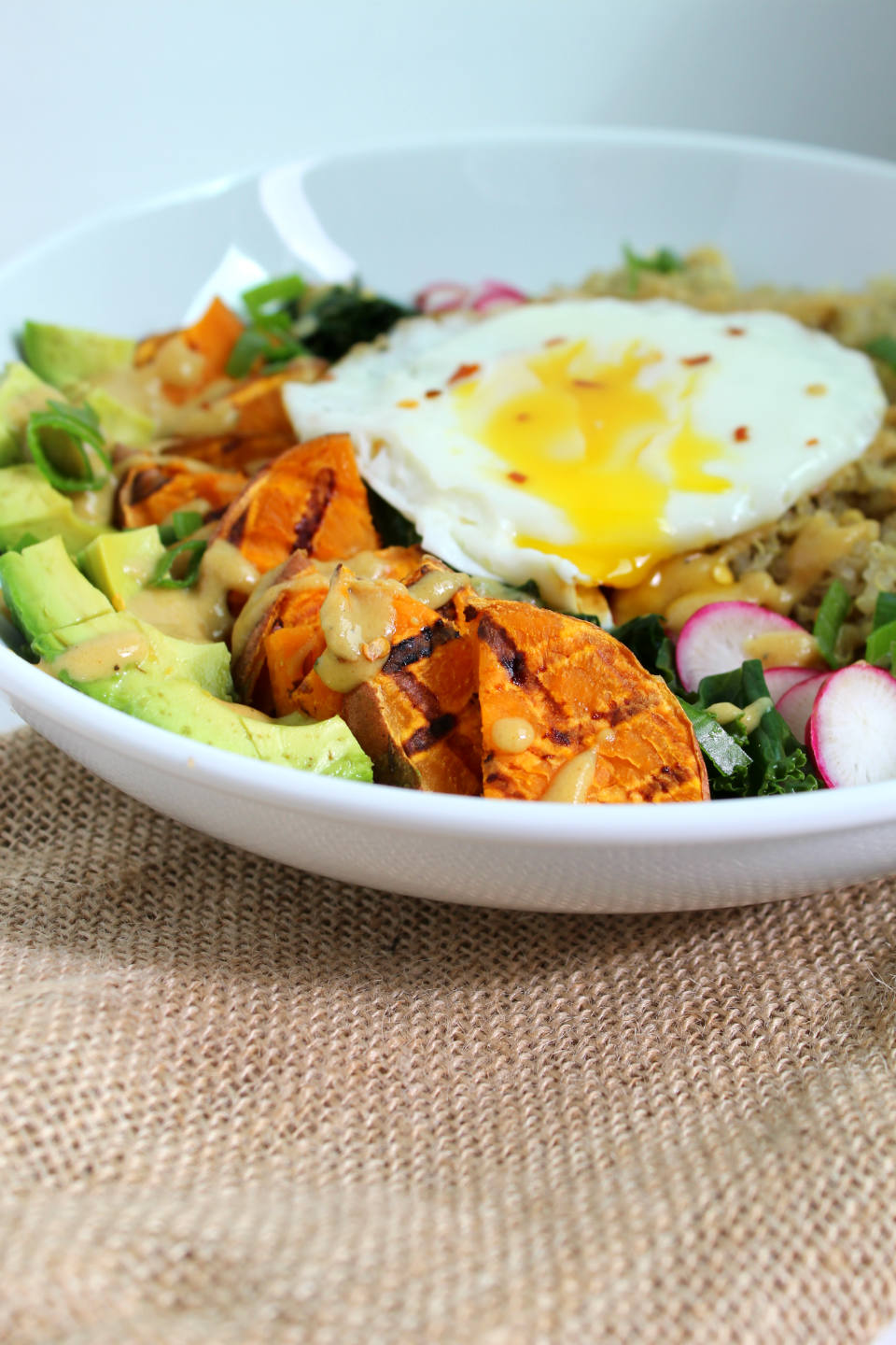 Vegetarian Breakfast Power Bowl with Maple Dijon Dressing -- A veggie-filled recipe with quinoa, sweet potato, avocado, eggs, and creamy dressing. | @sinfulnutrition www.sinfulnutrition.com #thereciperedux