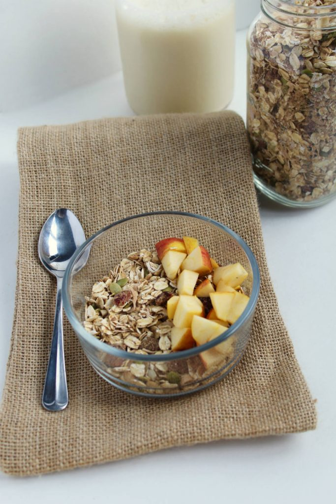 Pumpkin Spice Homemade Muesli in Bowl with Apples