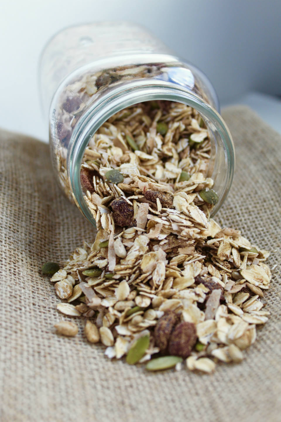 Pumpkin Spice Homemade Muesli Spilling Out of Jar