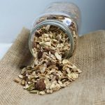 Pumpkin Spice Homemade Muesli Spilling Out of Glass Jar
