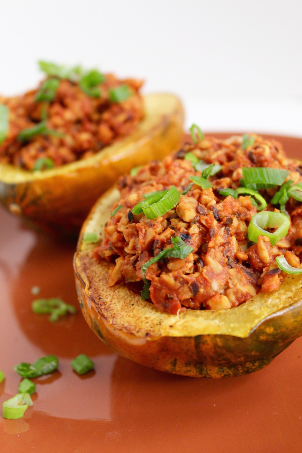 Smoky Tempeh Stuffed Acorn Squash topped with Green Onion