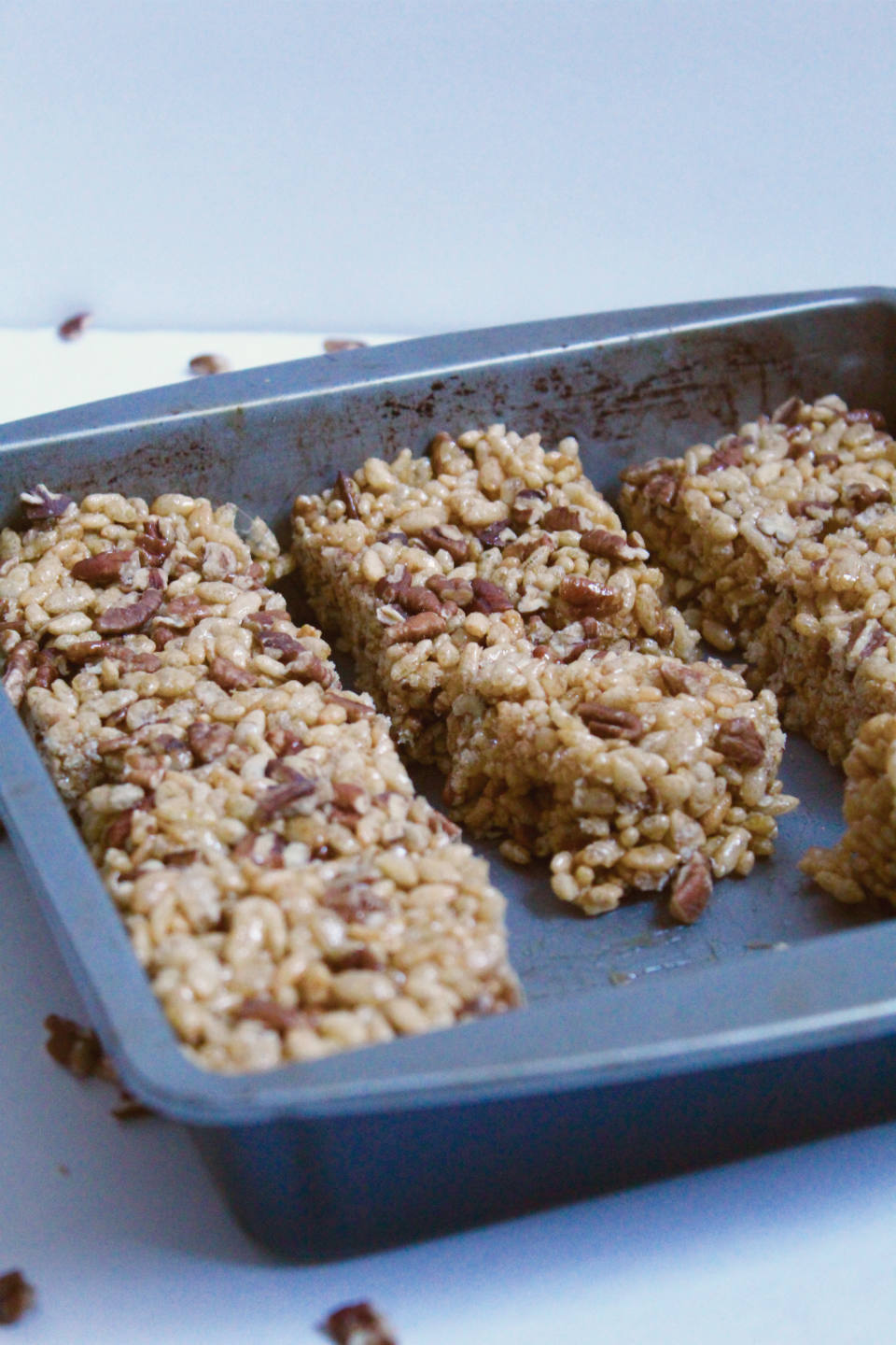 Pecan Pie Rice Krispie Treats -- Two classic dessert recipes join forces to make these addictingly sweet and gooey bars. No marshmallows required! | @sinfulnutrition #vegan #glutenfree