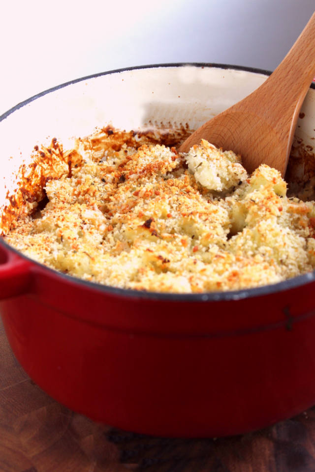 Creamy Cauliflower Gratin Recipe -- Fresh cauliflower smothered in a creamy Gruyere and Parmesan cheese sauce, and baked to crispy, bubbly perfection. The perfect holiday dinner side! | @sinfulnutrition