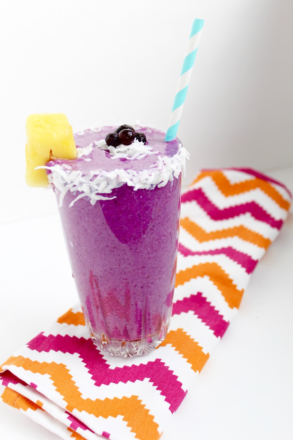 Wild Blueberry Pina Colada Smoothie Recipe -- A healthy start to your day with a tropical twist! Made with wild blueberries, frozen pineapple, and coconut water, it's a taste of the tropics in a glass! | @sinfulnutrition @wildbberries #AD #WildYourSmoothie