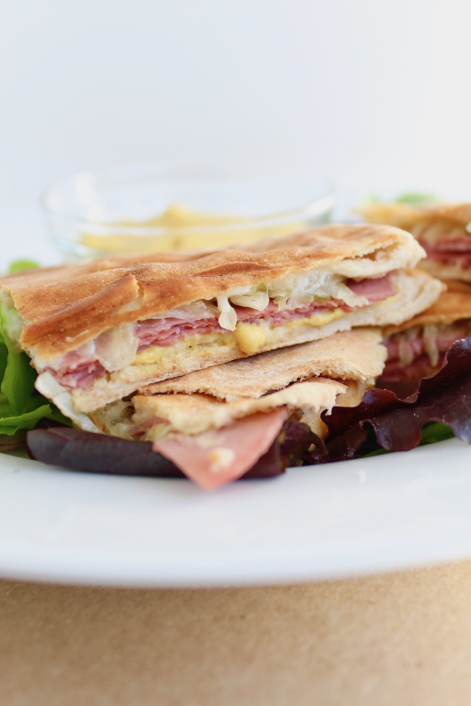 Corned Beef & Cabbage Quesadilla -- A corned beef sandwich recipe made with your St. Patty's Day meal leftovers, swiss cheese, and tangy mustard pressed into pita bread. | @sinfulnutrition | AD | @toufayan