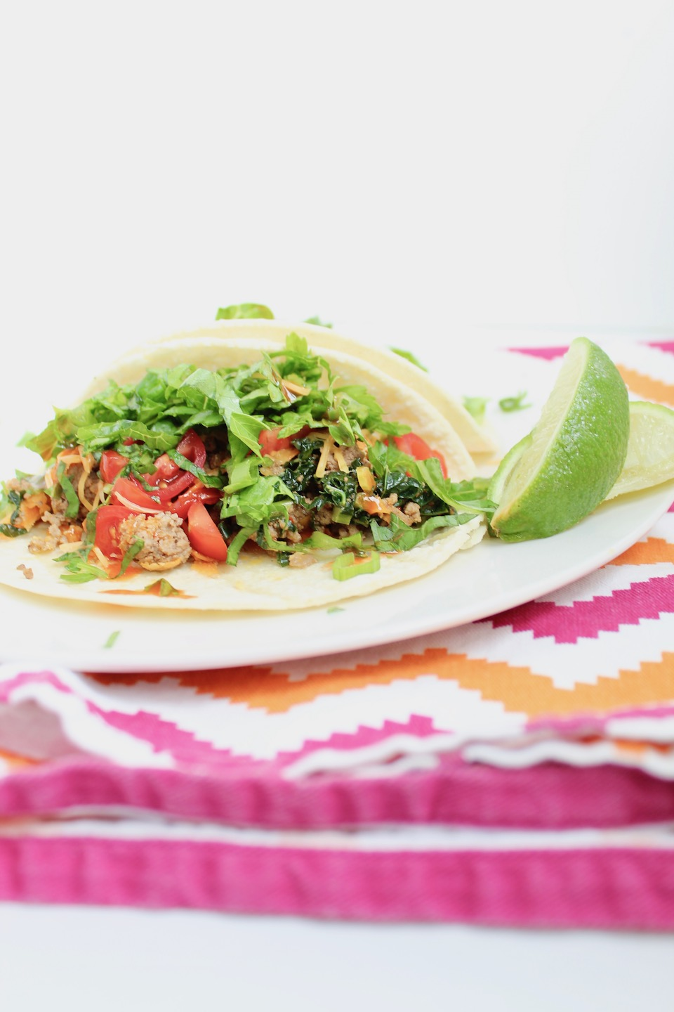 Veggie-Loaded Kitchen Sink Tacos -- A quick and healthy taco recipe that is packed full of flavor and toppings! A family dinner every one is sure to love! | @sinfulnutrition