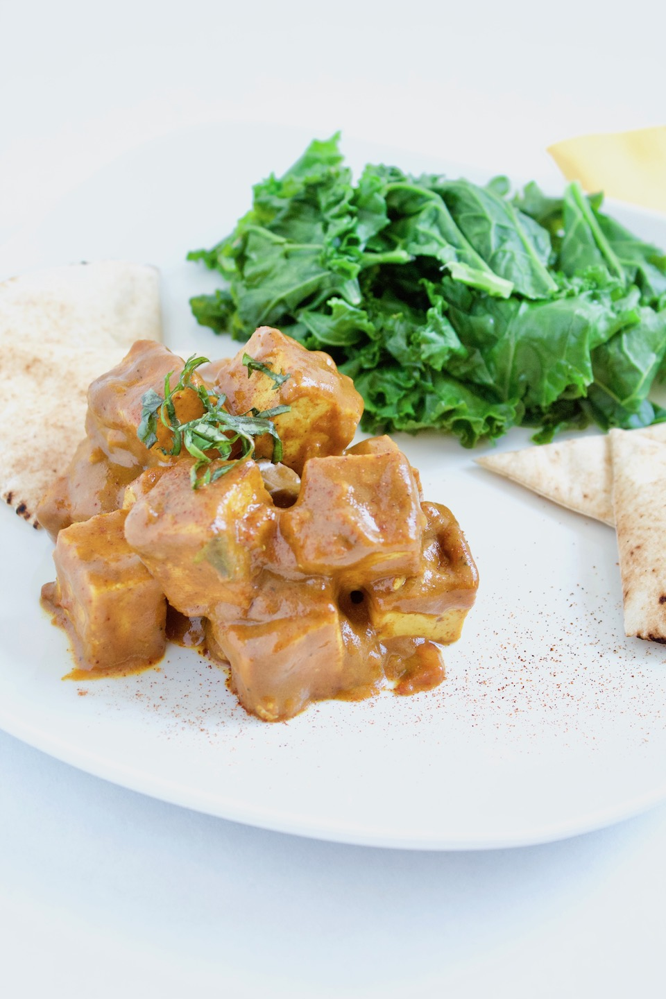 Vegetarian Paprikash Recipe -- This tofu smothered in a thick and spicy sauce makes a perfect meat-free dinner that's ready in under 30 minutes! | Vegan | Gluten-Free | Healthy Dinner | @sinfulnutrition
