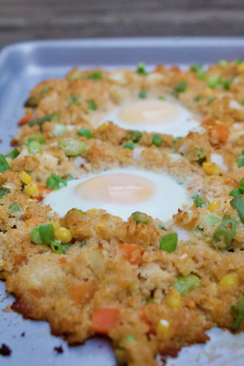 A low-carb and gluten free cauliflower fried rice recipe that's thrown on a sheet pan and baked in the oven. Only 7 ingredients, and made in under 20 minutes!| @sinfulnutrition | #thereciperedux