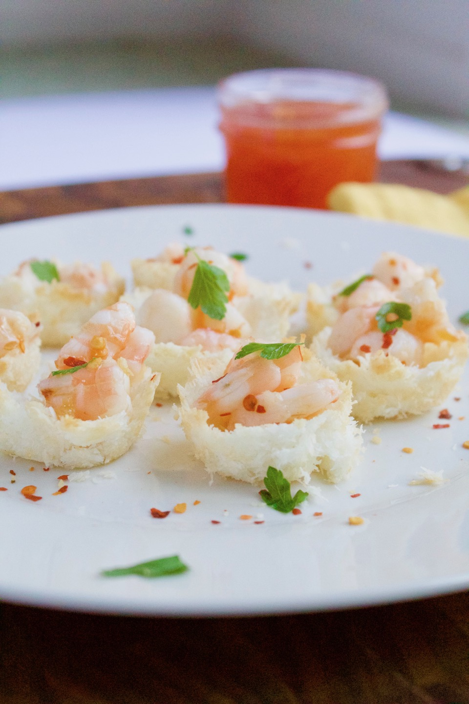 These baked coconut shrimp cups are a fun twist on a classic appetizer. An easy, and gluten-free party recipe that is sure to be a crowd-pleaser! | @sinfulnutrition | AD | #seafoodparty | @seafood4health