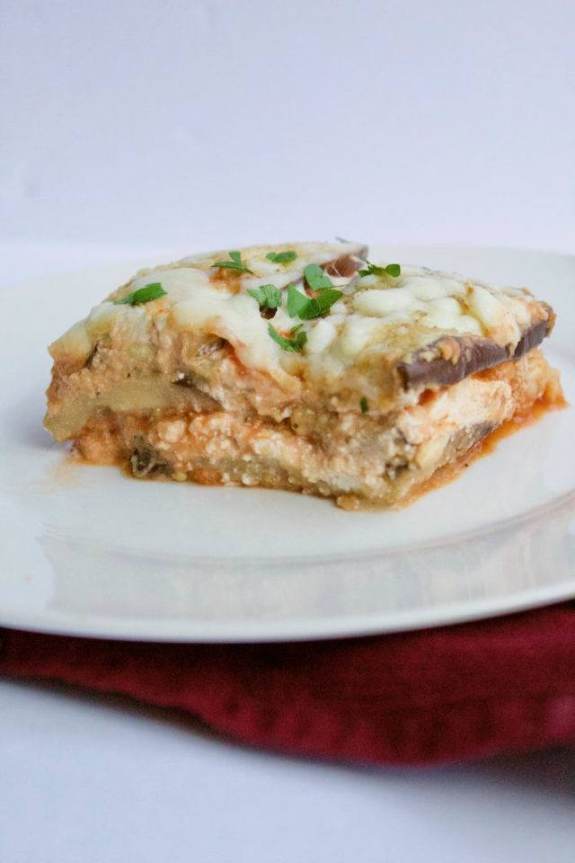Low-Carb Eggplant Parmesan Lasagna -- Two Italian favorites in one recipe! Eggplant parm noodles make this lasagna a healthy dinner that's both low-carb and gluten-free. | @sinfulnutrition #sinfulnutrition #lowcarblasagna #eggplantlasagnarecipe