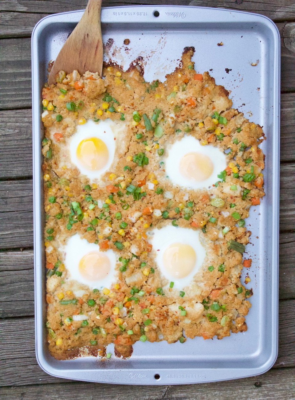 A low-carb and gluten free cauliflower fried rice recipe that's thrown on a sheet pan and baked in the oven. Only 7 ingredients, and made in under 20 minutes! | @sinfulnutrition | #thereciperedux