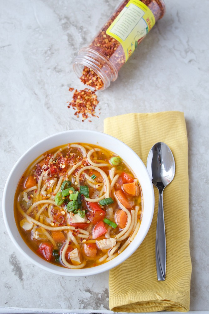 This Instant Pot Chicken Noodle Soup #recipe is infused with the flavors of sesame, ginger, and scallion. Makes a quick and easy #dinner, lunch, or any meal in between! | @sinfulnutrition #dairyfree