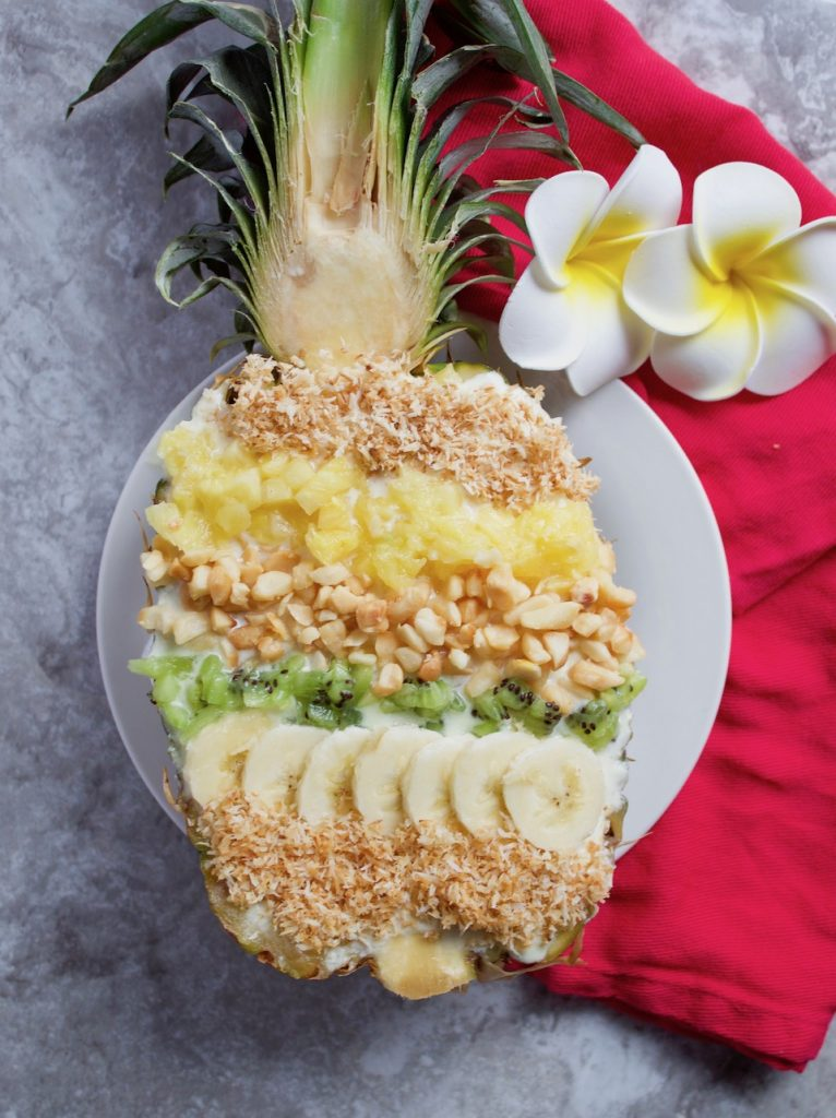 This Hawaiian pineapple #smoothie recipe is full of tropical flavor, made with only three simple ingredients, and all the toppings! Find this #vegan and #gluten-free recipe and more on sinfulnutrition.com | @sinfulnutrition