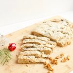 Christmas Stollen Recipe -- A hearty bread studded with dried fruit, chopped walnuts, and orange zest. The perfect holiday breakfast treat or even dessert! | @sinfulnutrition | #sinfulnutrition | #stollenrecipe | #christmasdesserts | #healthystollenrecipe | #christmasbaking