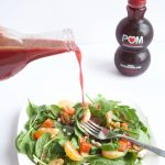 #AD Homemade Pomegranate Vinaigrette -- A quick and easy salad dressing recipe made with pomegranate juice, cider vinegar, and olive oil. So much better than store-bought! | #vegan | #glutenfree | #salad | @sinfulnutrition