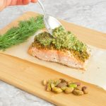 Pistachio Crusted Salmon with Citrus Gremolata - An easy and #healthy #dinner recipe for crispy baked #salmon topped with a fresh herb and citrus #gremolata sauce. | #sponsored | #getcrackin | @sinfulnutrition | #glutenfree | #dairyfree | #dinner | #seafood