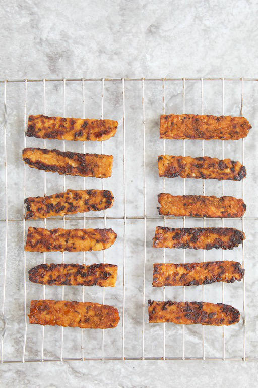 Homemade Tempeh Bacon -- An easy #plantbased recipe made in 15 minutes, no oven, or marinating time required! The perfect smoky and crispy addition to breakfast, a sandwich, salad, and more! | #vegan | #vegetarian | #glutenfree | #tempeh | #soy | #breakfast | #bacon | @sinfulnutrition