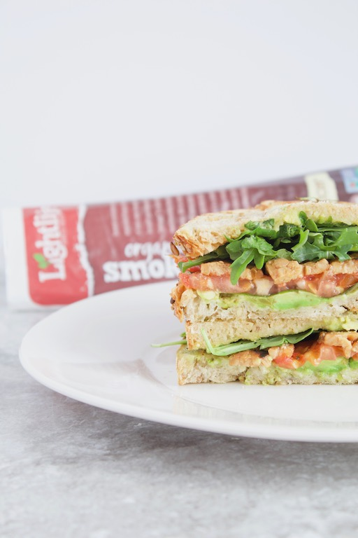 Vegan BLT Sandwich -- A recreation with a twist of the famous #TTLA from @WholeFoods made with @lightlife Tempeh Bacon, mashed avocado, spicy arugula, sliced tomato, and fresh basil on grilled sourdough bread. A hearty #vegan sandwich even meat-lovers will devour! | @sinfulnutrition | #sponsored | #tempeh | #sandwich | #bacon | #BLT | #vegetarian | #wholefoods | #plantbased | #lunch |