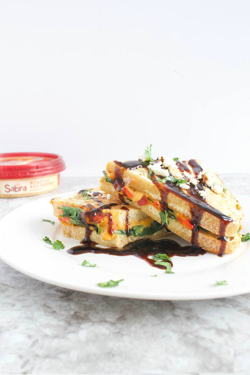 AD | Savory Stuffed French Toast -- A vegetarian savory french toast recipe made with sourdough bread, @sabra red pepper hummus, feta cheese, and sautéed spinach. A meal fit for breakfast, brunch, or dinner! | @sinfulnutrition #sinfulnutrition  #thereciperedux | #sabra | #unofficialmeal | #savoryfrenchtoast