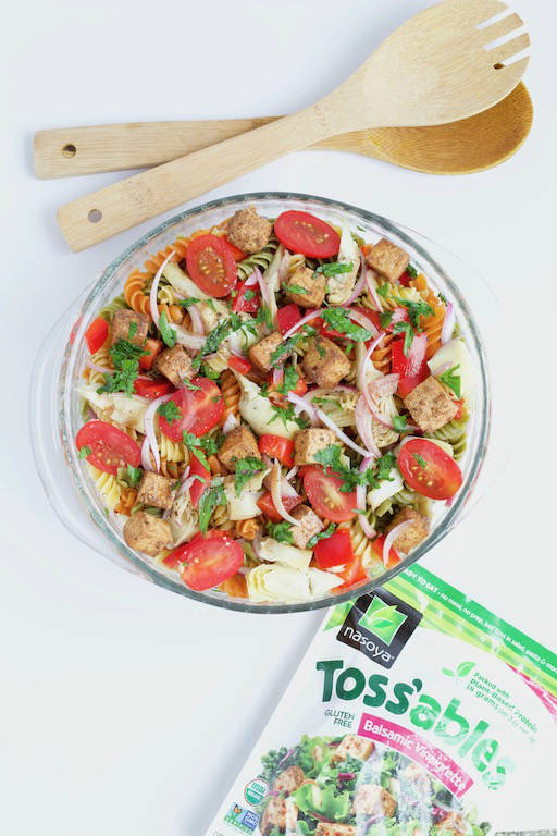 AD: Balsamic Pasta Salad with Tofu -- A classic summer recipe made with sweet and tangy balsamic vinaigrette, tri-color pasta, artichoke hearts, bell pepper, and @nasoya balsamic #tofu. A #vegan friendly side dish for any #cookout or #barbecue! | @sinfulnutrition | #nasoya | #vegetarian | #pasta | #plantbased | #onemoreplant | #sidedish