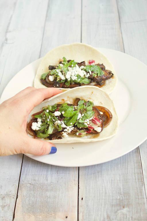 Hand Grabbing Portobello Mushroom Tacos