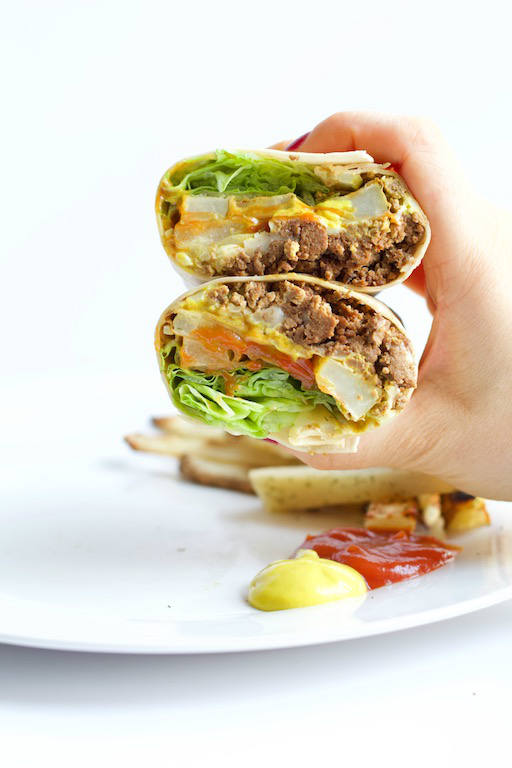 burger burrito layered in hand