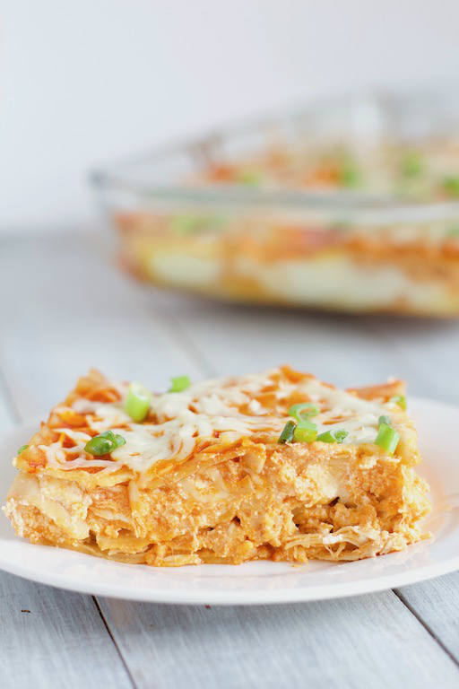 Buffalo Chicken Lasagna Recipe -- A dinner for any spicy food lover! Perfect for football season, game night, or any weekday | @sinfulnutrition | #sinfulnutrition | #buffalo | #chicken | #football | #gameday | #maindish | #entree | #dinner | #lasagna | #pasta | #spicyfood