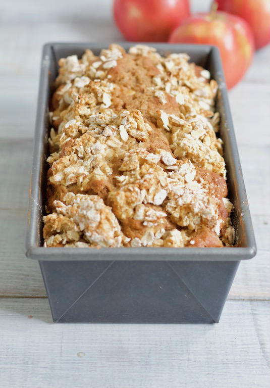 This easy apple bread recipe only takes one bowl and a few simple ingredients to make. The perfect fall treat that will instantly make your house smell amazing! | @sinfulnutrition | #sinfulnutrition | #quickbread | #fallrecipe | #applerecipe | #wholegrain | #healthyrecipe | #autumn | #apples