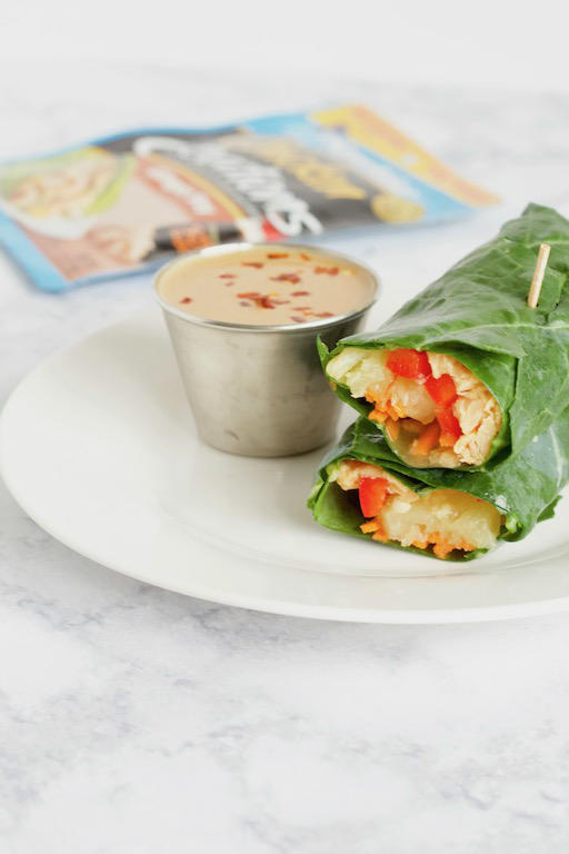 AD | These Asian Collard Green Wraps are filled with a ginger soy chicken, fresh vegetables, and pineapple, and served with a tangy peanut sauce for dipping. A perfect recipe for a light lunch or satisfying snack! | @sinfulnutrition | #sinfulnutrition | #collardwraps | #lowcarbwraps | #asianchickenwraps | #TearEatGo | #StarKistChickenCreations | #FNCE | @StarKistCharlie