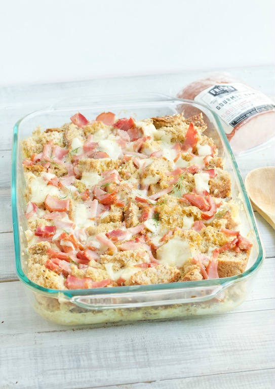 AD: This Savory Bread Pudding recipe made with hearty bread, ham, swiss cheese, and eggs is an easy make-ahead main dish for breakfast, brunch, or even dinner! @sinfulnutrition | #sinfulnutrition | #breakfastcasserole | #frenchtoastcasserole | #makeaheadbreakfast | #dinnercasserole | #savorybreadpudding | #ItsFrickinGood | #Fricks | #SmokedMeats