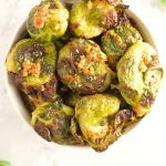 These Garlic Parmesan Smashed Brussels Sprouts are an easy side dish that will have any green veggie hater changing their minds! Great for your holiday spread, or to jazz up a weeknight dinner in under 30 minutes! | @sinfulnutrition | #sinfulnutrition | #sidedish | #vegetablerecipe | #brusselsprouts | #ThanksgivingSideDish | #HolidaySideDish