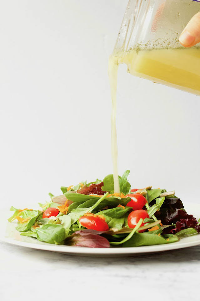 This dill pickle vinaigrette is a simple salad dressing recipe made with leftover pickle juice. The ultimate dressing for pickle lovers!   @sinfulnutrition #sinfulnutrition #pickledressing #dillpicklerecipes