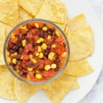 This quick and easy Black Bean and Corn Salsa recipe takes just 6 ingredients to make, with no chopping or cutting required! | @sinfulnutrition #sinfulnutrition #easyhomemadesalsa #blackbeancornsalsarecipe