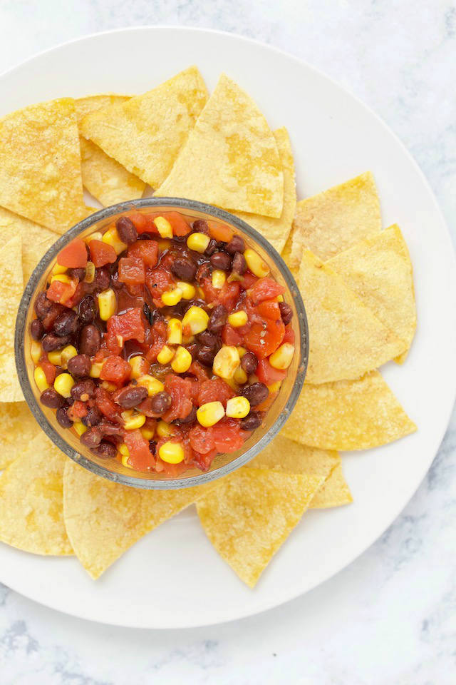 This quick and easy Black Bean and Corn Salsa recipe takes just 6 ingredients to make, with no chopping or cutting required!   @sinfulnutrition #sinfulnutrition #easyhomemadesalsa #blackbeancornsalsarecipe